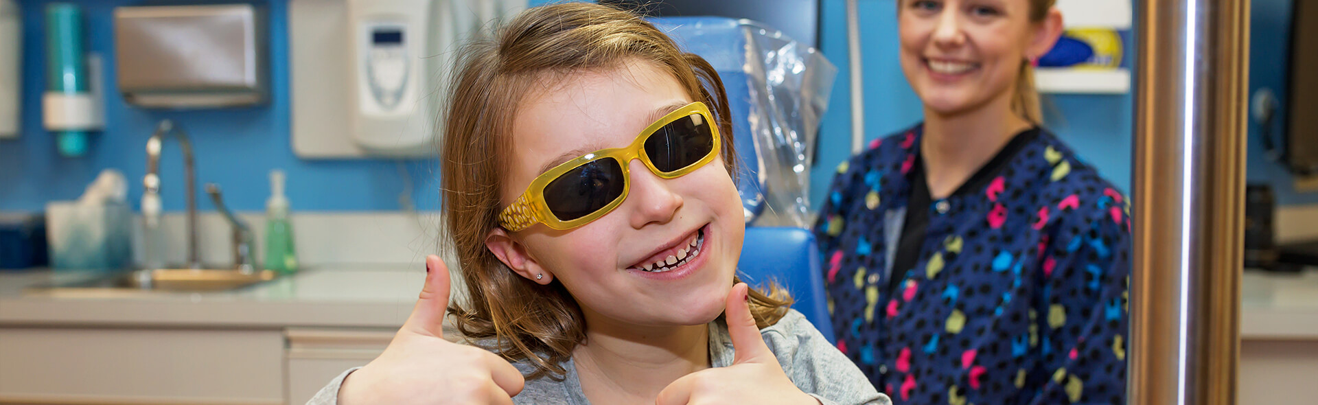 Girl with yellow glasses - Pediatric Dentist in Hales Corners, WI