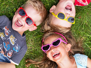 Kids in grass - Pediatric Dentist in Hales Corners, WI